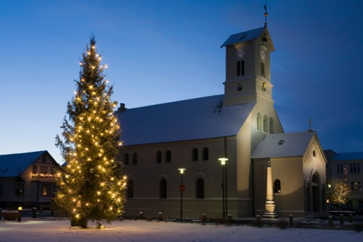 Stock Photo: 1598R-10000207 Christmas Tree and Church in snow in Reykjavik, Iceland