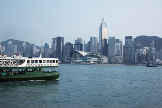 View of Hong Kong cityscape and ferry over the Victoria Harbour. : Stock Photo