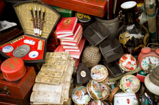 Various 'antiques' and 'relics' for sale at the the numerous stalls that line Dongtai Road.Dongtai Road Market caters mainly to foreigners looking for 'antiques', 'relics' and other 'pre-revolutionary' items, all of which are usually mass-produced and treated to look aged, like the originals. : Stock Photo