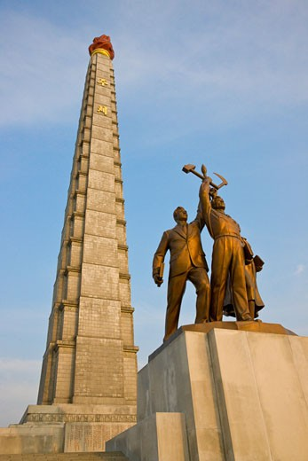 Tower of Juche Idea and statues, Pyongyang, North Korea : Stock Photo