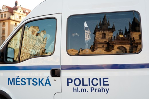 Stock Photo: 1598R-10001346 Old Town Square (Starom?stsk? n?m?st?) is a historic square in the Old Town quarter of Prague in the Czech Republic. Famous Gothic Tyn Cathedral is reflected in the van window.