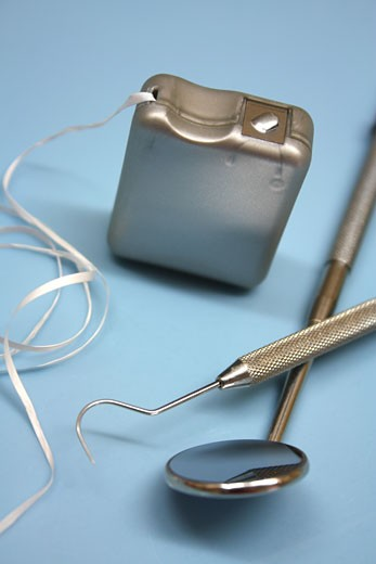 Dental tool, floss and mirror.  : Stock Photo