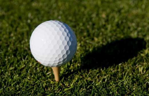 Stock Photo: 1598R-10004188 Golf ball on a golf tee in the grass