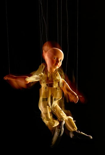 Stock Photo: 1598R-10005166 Antique puppet in motion