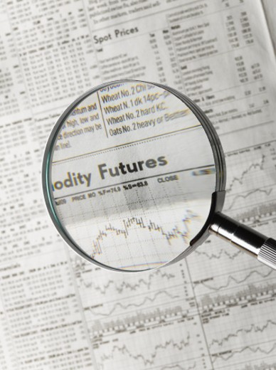 Stock Photo: 1598R-10006162 Magnifying glass over stock market graphs