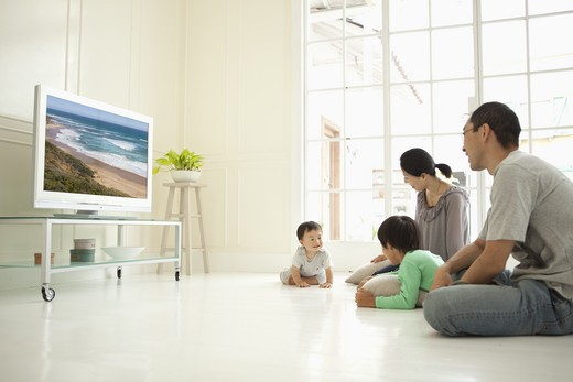 Stock Photo: 1598R-10006596 A family relaxing in the living room.
