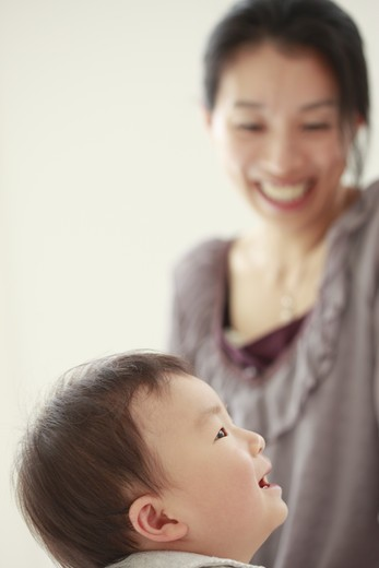 Mother looking at a little boy smilling. : Stock Photo