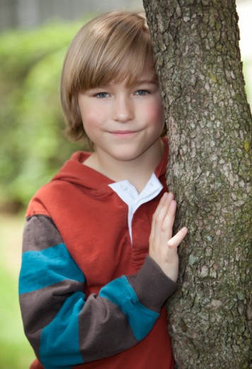 Stock Photo: 1598R-10006847 Boy next to a tree.