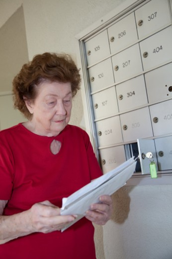 Stock Photo: 1598R-10006884 A woman receives her mail