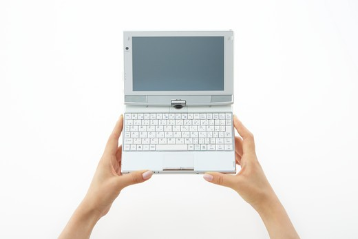 Holding a mini notebook PC. : Stock Photo