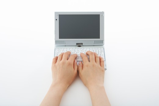 Stock Photo: 1598R-10006976 Operating a mini notebook PC.