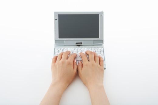 Operating a mini notebook PC. : Stock Photo