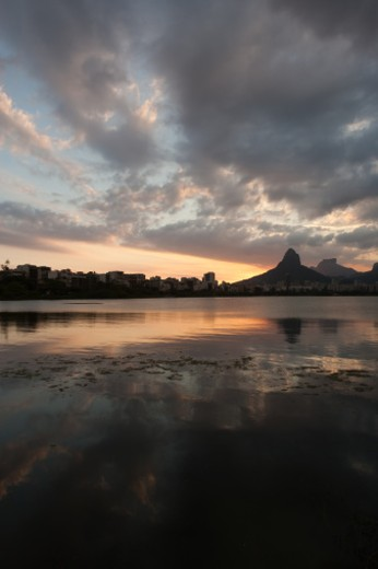 Rodrigo de Freitas lagoon reflecting Ipanema buildings at left and Two Brothers mountain in the middle. : Stock Photo