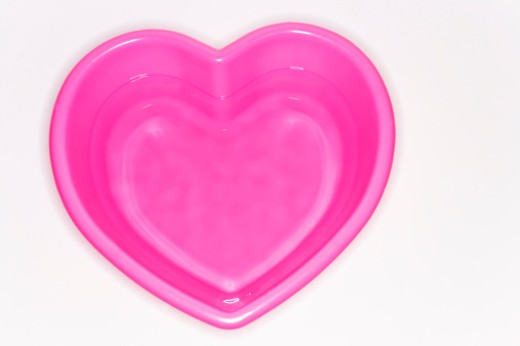 Water is in the heart-shaped pail : Stock Photo