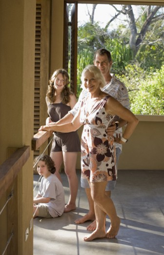grand parents and grand children in tropical house : Stock Photo