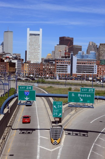 Stock Photo: 1598R-10008676 I-90 and I-93 against the Boston skyline.Boston is one of the oldest cities in the United States and largest city in new England.  It has been the scene of major events in US history including the Boston Tea Party and the Battle of Bunker Hill.
