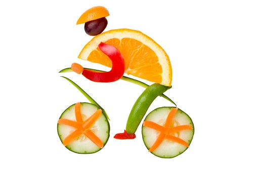 Bike rider arranged out of fruit and vegetables, studio shot : Stock Photo