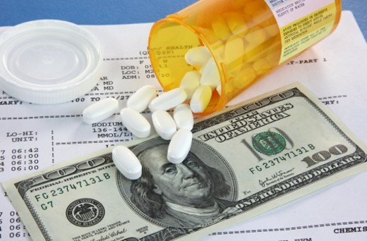 Stock Photo: 1598R-10011906 Prescription bottle and currency on medical report for high cost of healthcare concepts