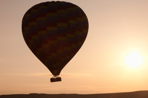 Stock Photo: 1598R-10012166 Silhouetted hot air balloon