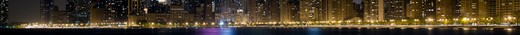 Stock Photo: 1598R-10012334 Close-up panoramic view of the Chicago lakefront at night.