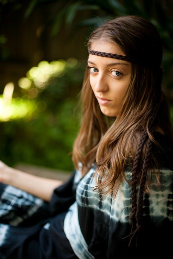Stock Photo: 1598R-10012715 Young hippie woman, seated in a garden