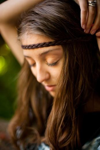 Hippie girl, posing in a garden : Stock Photo