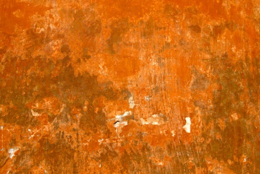 Stock Photo: 1598R-10013442 Run-down, rustic and old ochre wall. Great background image for various usages.