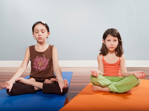 2 girls practicing yoga : Stock Photo