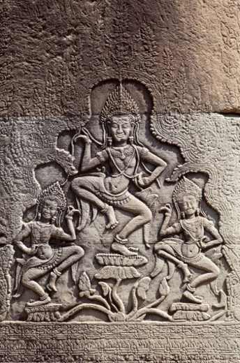Bas-relief sculpture. An Apsaras is a female spirit of the clouds and waters in Hindu and Buddhist mythology. : Stock Photo