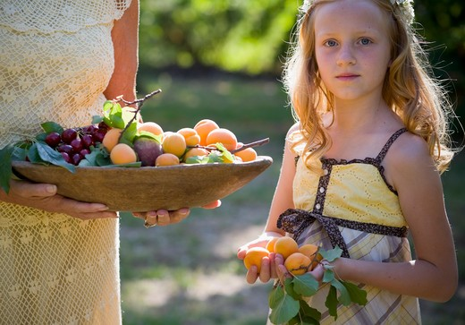Portrait of young girl with freshly picked fruit : Stock Photo
