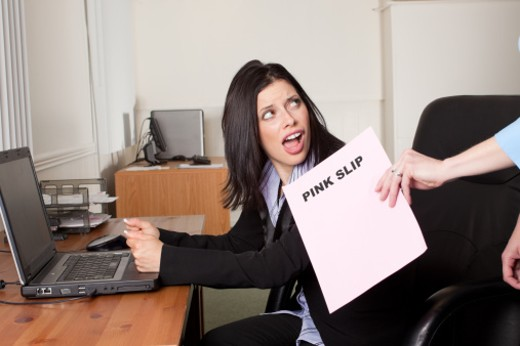 Stock Photo: 1598R-10015676 A shocked business woman receiving an pink slip.