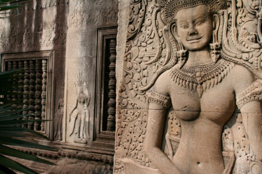 Stock Photo: 1598R-10015783 Angkor Wat, is a temple complex at Angkor, Cambodia.  The images depict bas relief figures of Hindu episodes of Ramayana and the Mahabharata.