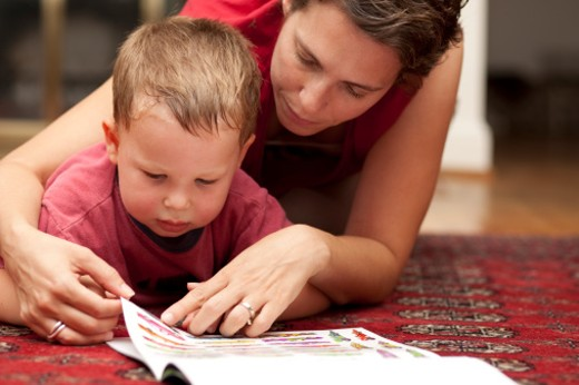 Mother and child reading : Stock Photo