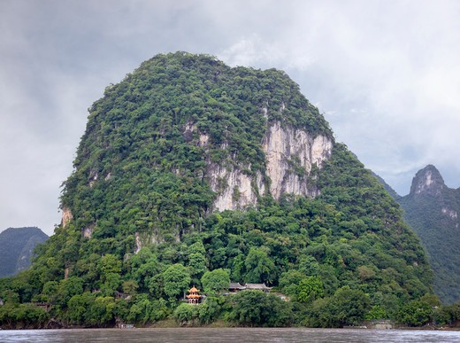 Stock Photo: 1598R-10018219 A karst (pointed hill) along the Li River near Yangshuo