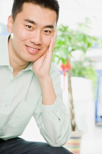 Stock Photo: 1598R-10019571 Asian man smiling