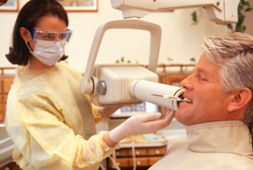 Patient sitting in dentists surgery, having dental X-Ray : Stock Photo