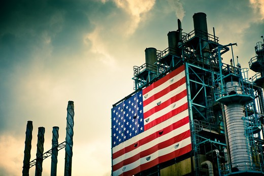 Stock Photo: 1598R-10023116 A massive United States flag adorns smoke stacks on an oil refinery in Southern California