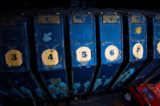 Numbered cases holding the reels for the night's feature in the projection booth of an old movie theater : Stock Photo