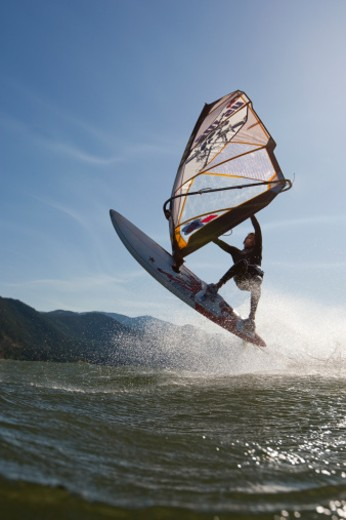 Boy windsurfing the Columbia River Gorge : Stock Photo