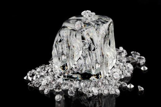 Stock Photo: 1598R-10023970 ice cubes melting into diamonds