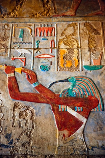 Stock Photo: 1598R-10025376 Color hieroglyphics and a carving of the Egyptian God Thot, on a wall at the Karnak Temple Complex.