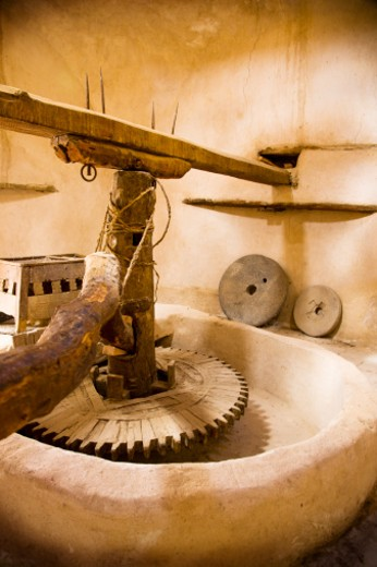 A millstone for milling grain at the St. Bishoi Coptic Monastery. The monastery was founded in the fourth century AD. : Stock Photo