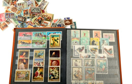 Postage stamp collecting is one of the world's most popular and inexpensive hobbies. : Stock Photo