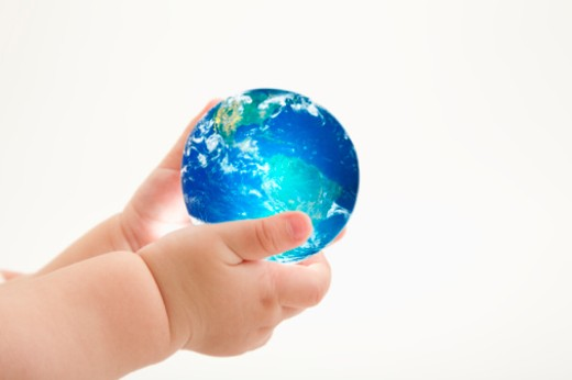 Baby hand holding the globe. : Stock Photo