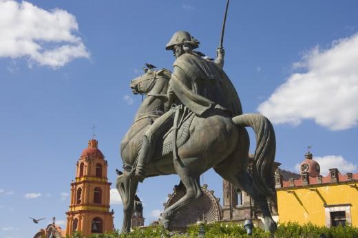 Stock Photo: 1598R-10029937 The rider is San Miguel's most famous son, General Ignacio Maria Allende y Unzaga, born here in 1769, San Miguel de Allende, Mexico. Protective town of San Miguel and the Sanctuary of Jesús Nazareno de Atotonilco is a UNESCO World Heritage site.