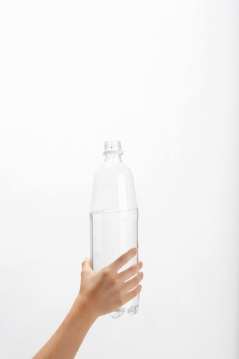 Stock Photo: 1598R-10030956 Hand of child who has PET bottle