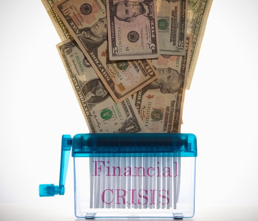 'Financial CRISIS' sign is on the shreddered paper. : Stock Photo