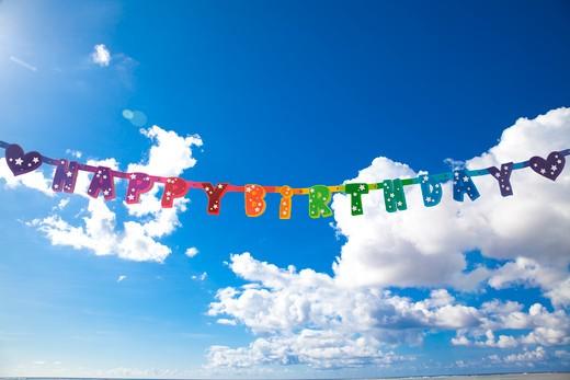 Stock Photo: 1598R-10031211 'HAPPY BIRTHDAY' bunner in the sky.