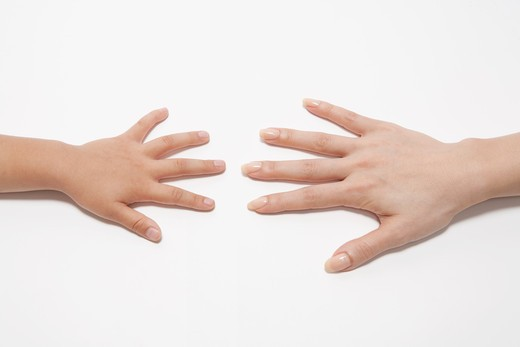 Hand of parent and child who compares size of hand : Stock Photo
