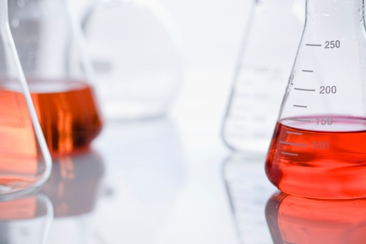 Collection of 250 ml beakers with red liquid in some of them. : Stock Photo